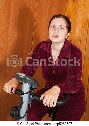 Woman working out on spinning bike - csp5262507