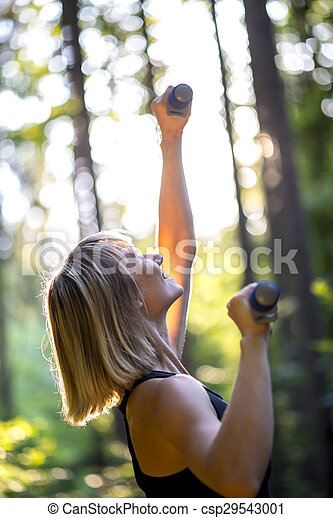 Woman working out outdoors in woodland - csp29543001