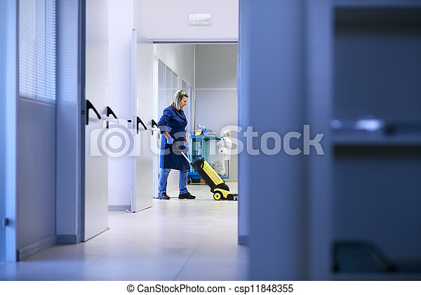Woman working, professional maid cleaning and washing floor with machinery in industrial building - csp11848355