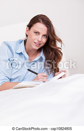 Woman writing in her diary - csp10824805