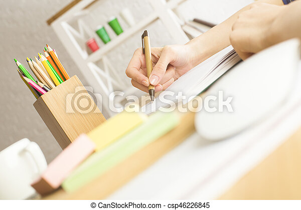 Woman writing in notepad - csp46226845