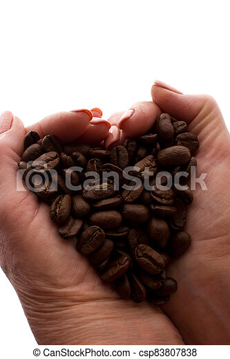 Woman's hand a handful of coffee beans - silhouette - csp83807838