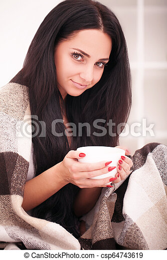 Woman's hand holding a cup of coffee. With a beautiful winter manicure. Drink, fashion, morning - csp64743619