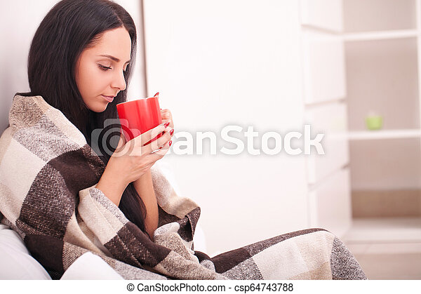 Woman's hand holding a red cup of coffee. With a beautiful winter manicure. Drink, fashion, morning - csp64743788