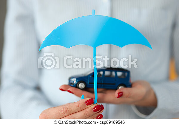 Woman's hand holds car and an umbrella - csp89189546