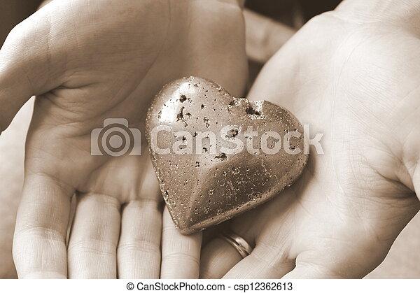 Woman's hands holding heart - csp12362613