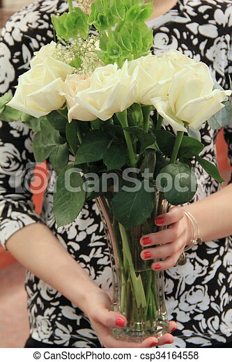 Woman's hands holding roses - csp34164558