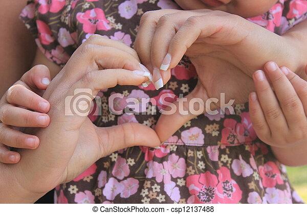 woman's hands in shape of heart - csp12137488