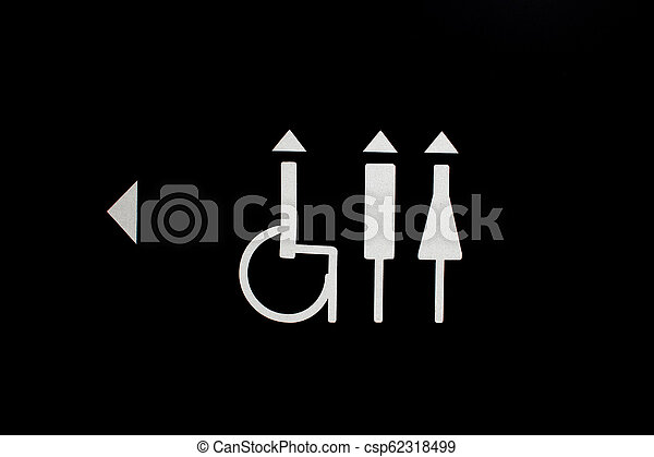 Women and Men Toilet Sign on black background - csp62318499