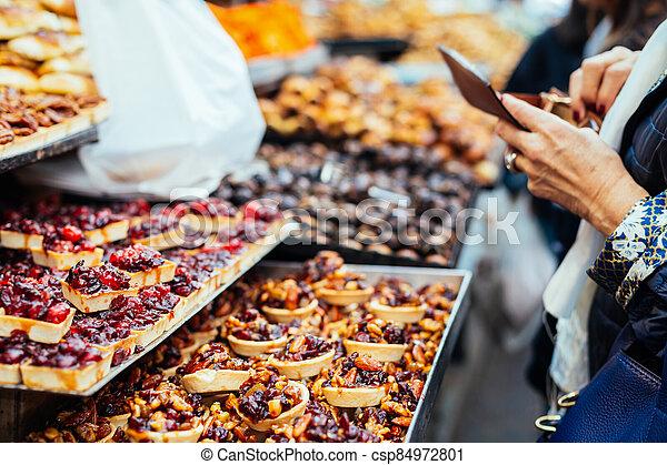 Women buing sweets in the Jerusalem market, Israel. - csp84972801