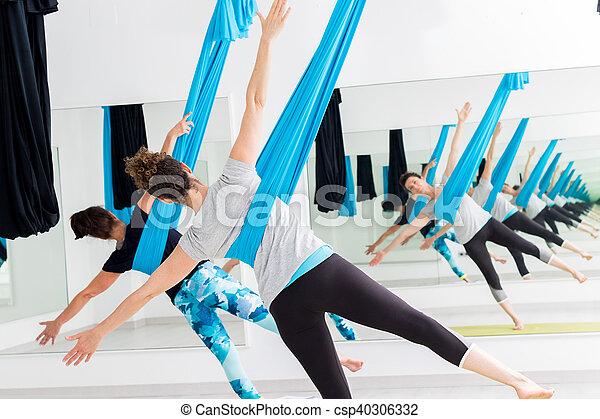 Women doing aerial yoga. - csp40306332