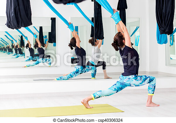 Women doing realigning yoga exercise. - csp40306324