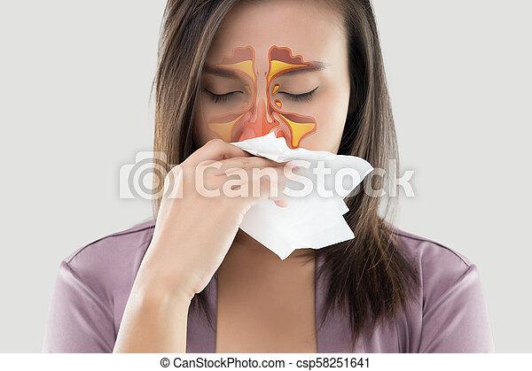 Women feeling unwell and sinus on gray background - csp58251641