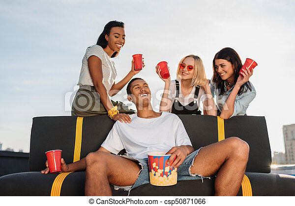women flirting with young man on party - csp50871066