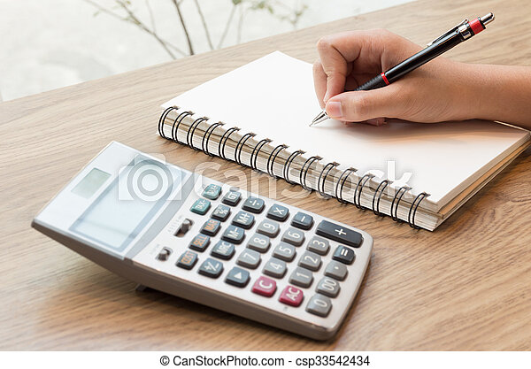 Women hands writing with pencil, notebook and Calculator - csp33542434