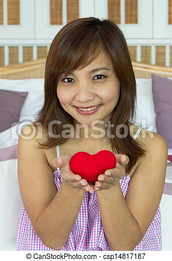 Women happiness with heart shape in hands - csp14817187