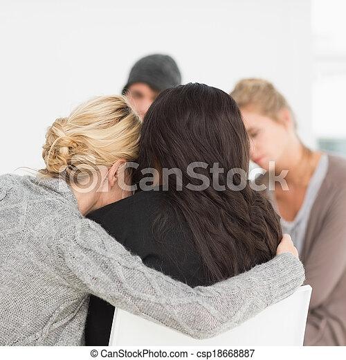 Women hugging in rehab group - csp18668887