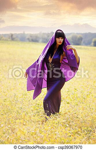 women in a purple cloak - csp39367970