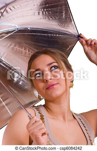 women in golden dress with a silver umbrella - csp6084242
