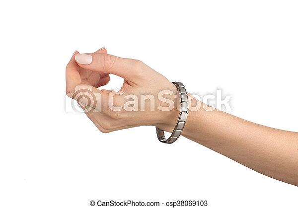 Women left hand with magnetic bracelet - csp38069103