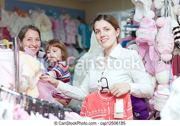 women of three generations  at clothes store - csp12506185