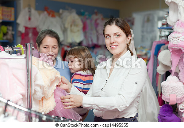 women of three generations at clothes store  - csp14495355