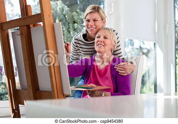 Women portrait with happy mom painting and daughter smiling - csp9454380