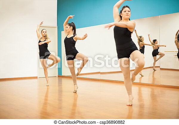 Women practicing a dance routine