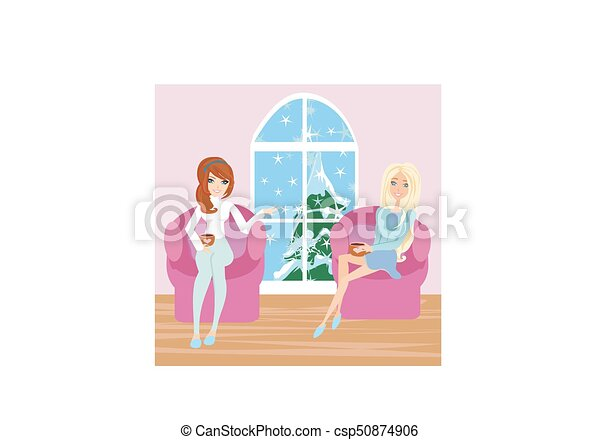 women talking over a cup of coffee - csp50874906