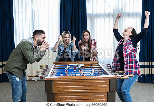Women win match in foosball. Cheerful group of girls excited with ... 0a70d8da7d
