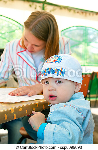 women with a little boy in cafe - csp6099098