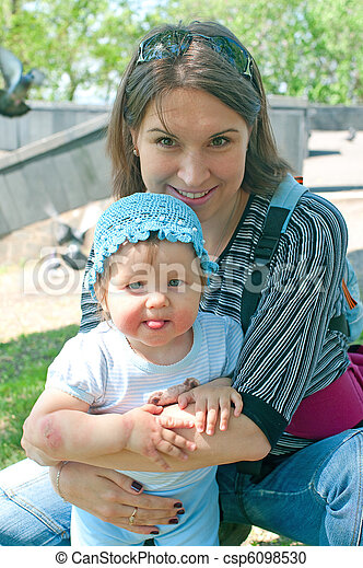 women with a little child in blue - csp6098530