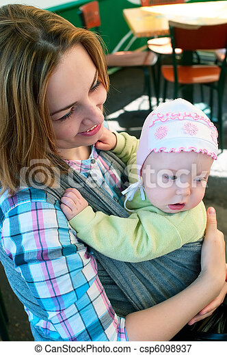 women with a little child in cafe - csp6098937