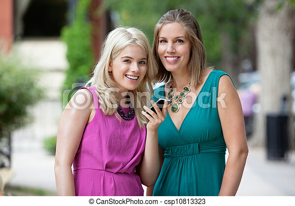 Women With Cellphone Smiling - csp10813323