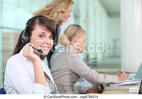 Women working in a call center - csp8784214