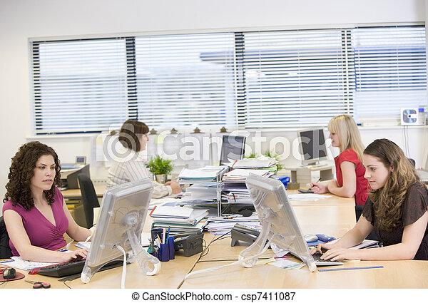 Women working in an office - csp7411087