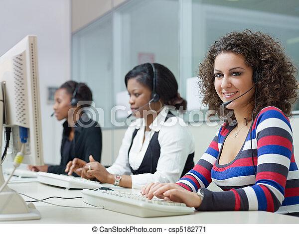 women working in call center - csp5182771