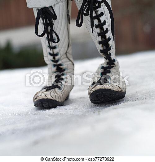 Womens boots on the snow - csp77273922