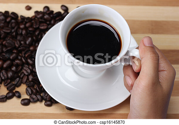 Women's hand holding a coffee cup - csp16145870