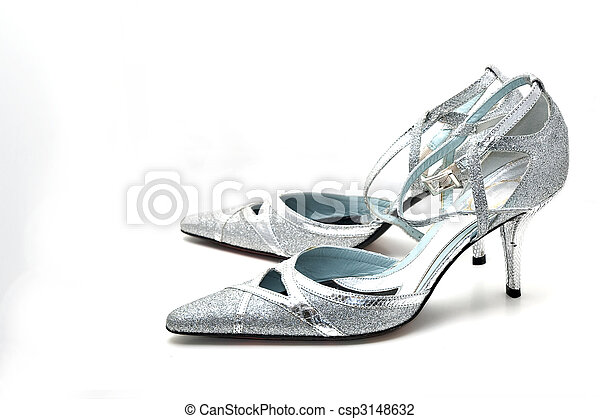 ac57561eb1f Women  s silver high heel shoes on white background.