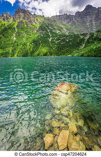 Wonderful blue lake in the mountains at sunrise, Poland, Europe - csp47204624