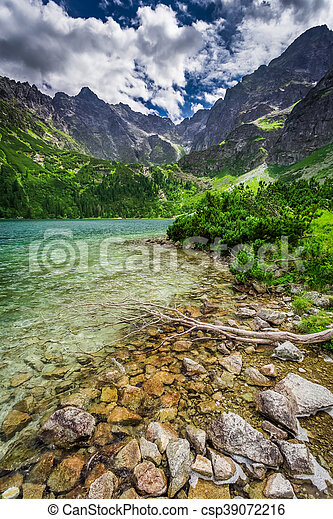 Wonderful lake in the middle of the mountains at sunrise - csp39072216