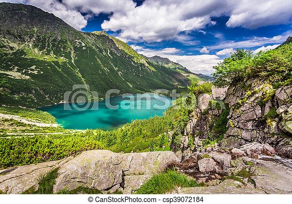 Wonderful lake in the mountains at sunrise - csp39072184
