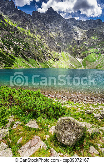 Wonderful lake in the Tatra Mountains at sunrise - csp39072167