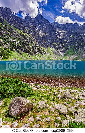Wonderful lake in the Tatra Mountains at sunrise - csp39091259