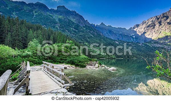Wonderful sunrise at lake in the Tatra Mountains in Poland - csp42005932