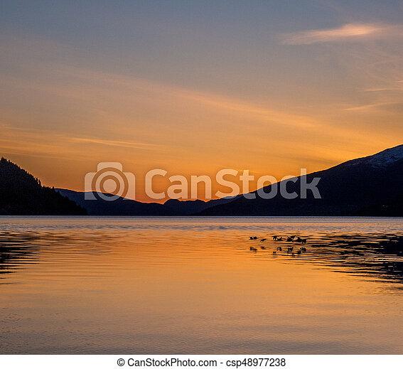 Wonderfull sunset Norway - csp48977238