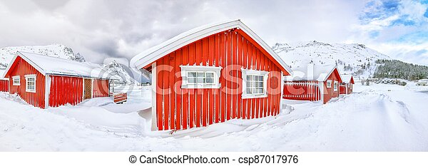 Wonderfull winter scenery with traditional Norwegian red wooden houses on the shore of Rolvsfjord on Vestvagoy island - csp87017976