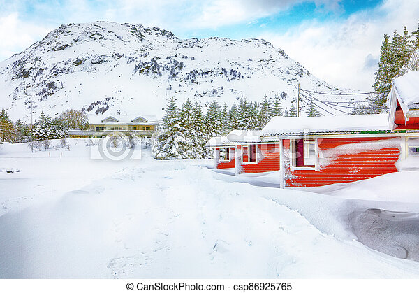 Wonderfull winter scenery with traditional Norwegian red wooden houses on the shore of Rolvsfjord on Vestvagoy island - csp86925765