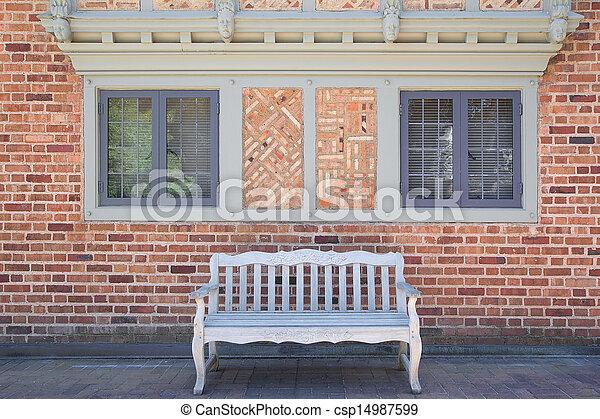 Woning baksteen hout buitenkant bankje. bakstenen brengen